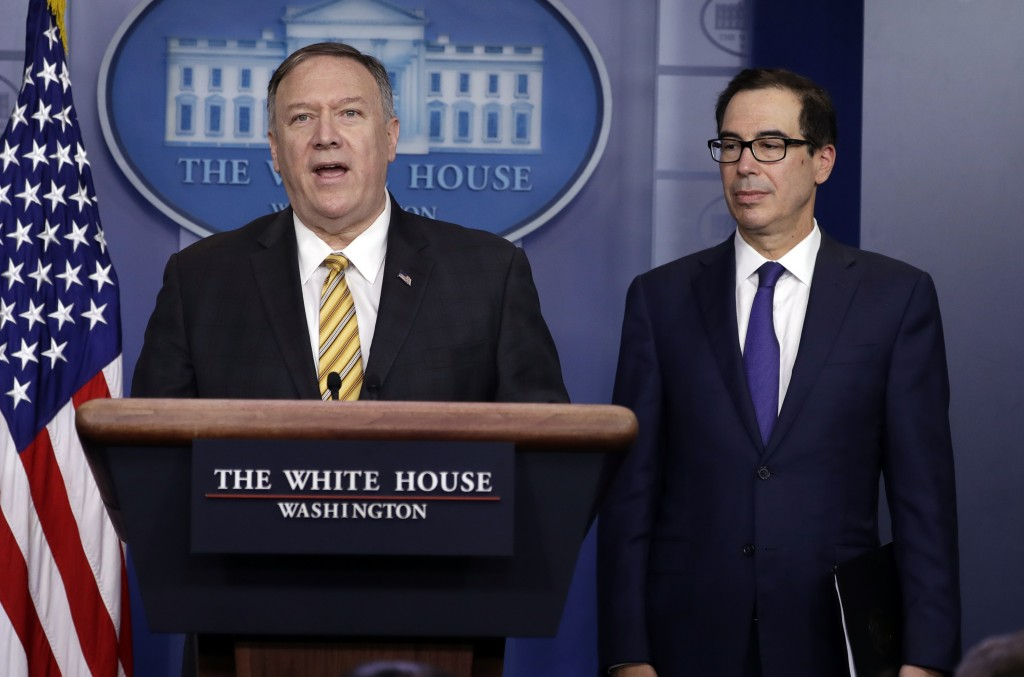 Secretary of State Mike Pompeo speaks as Treasury Secretary Steve Mnuchin listens during a briefing on terrorism financing at the White House, Tuesday