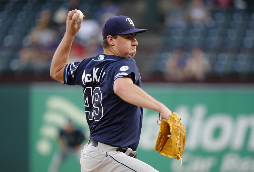 Tampa Bay Rays starting pitcher Brendan McKay throws to a Texas Rangers batter during the first inning of a baseball game in Arlington, Thursday, Texa...