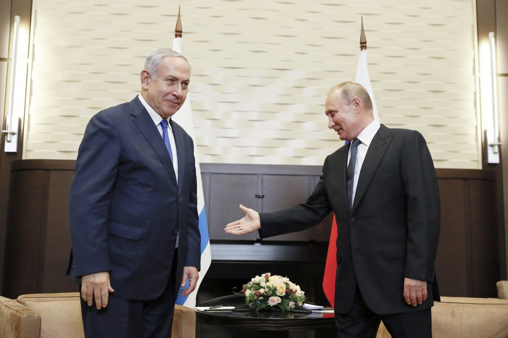 Russian President Vladimir Putin, right, welcomes Israeli Prime Minister Benjamin Netanyahu during their meeting in Sochi, Russia, Thursday, Sept. 12,...