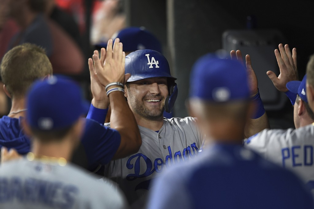 Los Angeles Dodgers' A.J. Pollock is congratulated after scoring on a double by Cody Bellinger against the Baltimore Orioles in the sixth inning of a ...