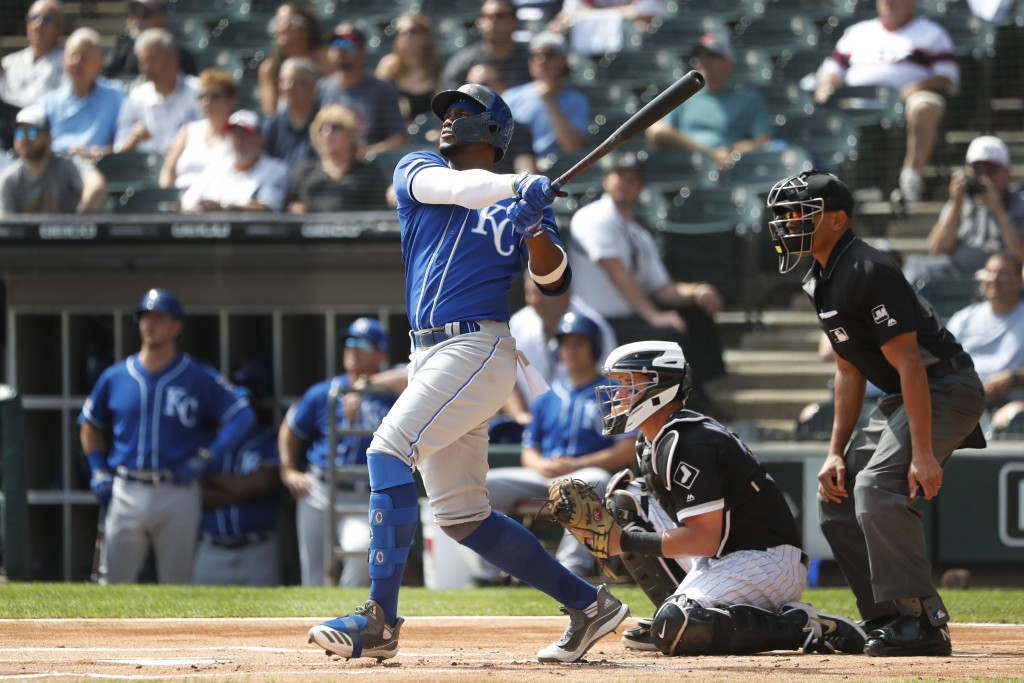 Kansas City Royals' Jorge Soler watches his home run off Chicago White Sox starting pitcher Lucas Giolito as catcher James McCann and umpire Jeramine