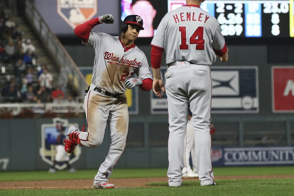 Washington Nationals' Juan Soto, left, rounds third base on a two-run home run off Minnesota Twins pitcher Kohl Stewart during the sixth inning of a b...