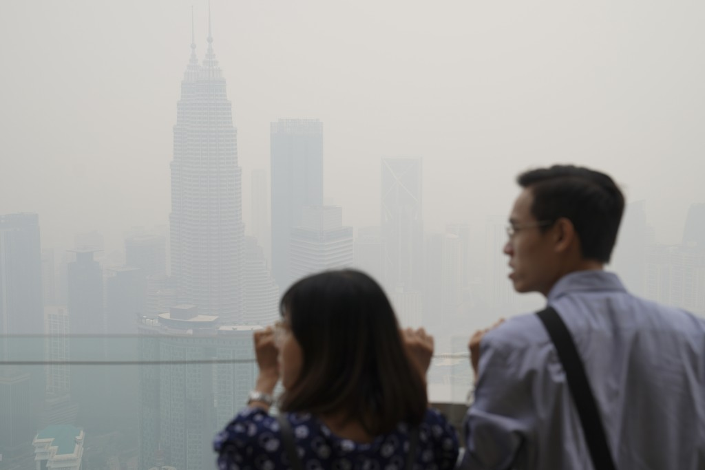 Tourists look out from Kuala Lumpur Tower as city stands shrouded with haze in Kuala Lumpur, Malaysia, Friday, Sept. 13, 2019. Malaysian authorities p...