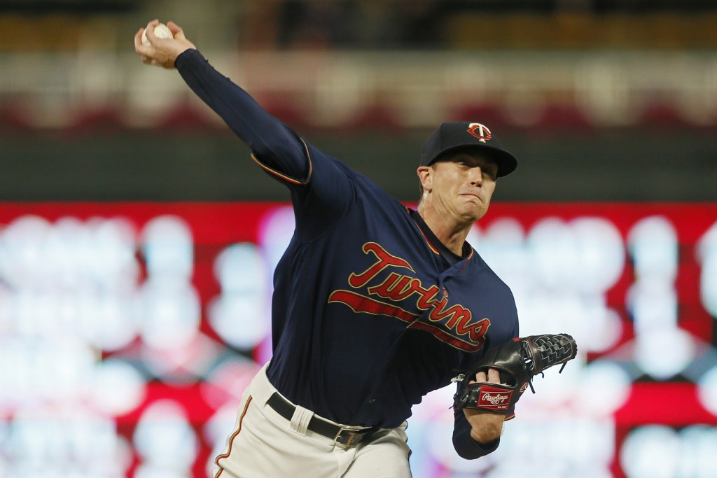 Minnesota Twins pitcher Kyle Gibson throws against the Washington Nationals in the first inning of a baseball game Thursday, Sept. 12, 2019, in Minnea...