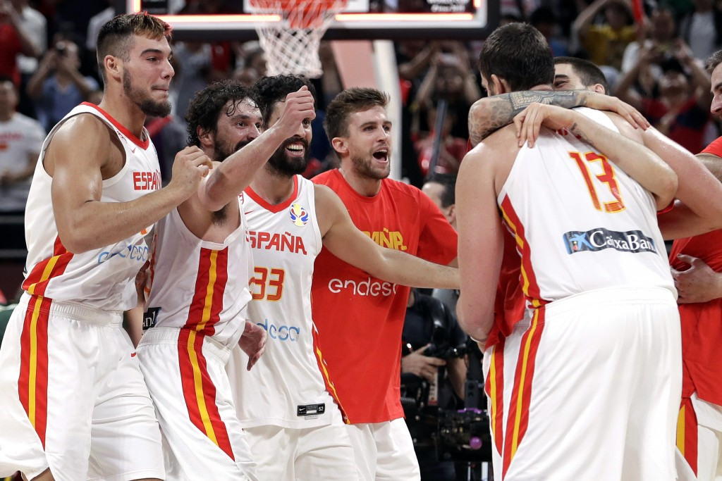 Members of Spain's team celebrate after winning their semifinal match against Australia in double overtime in the FIBA Basketball World Cup at the Cad...