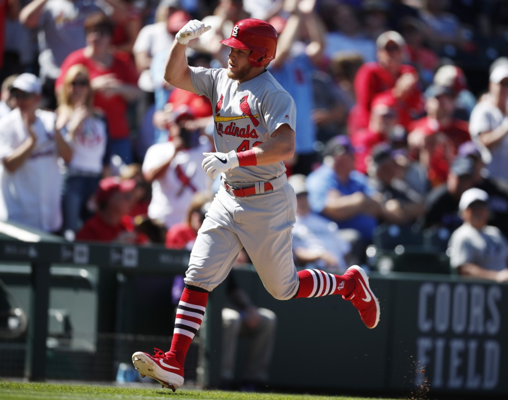 St. Louis Cardinals' Harrison Bader circles the bases after hitting a solo home run off Colorado Rockies relief pitcher Jesus Tinoco in the fourth inn