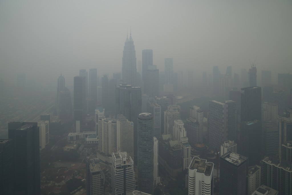 Kuala Lumpur city stands shrouded with haze in Kuala Lumpur, Malaysia, Friday, Sept. 13, 2019. Malaysian authorities plan to conduct cloud-seeding act