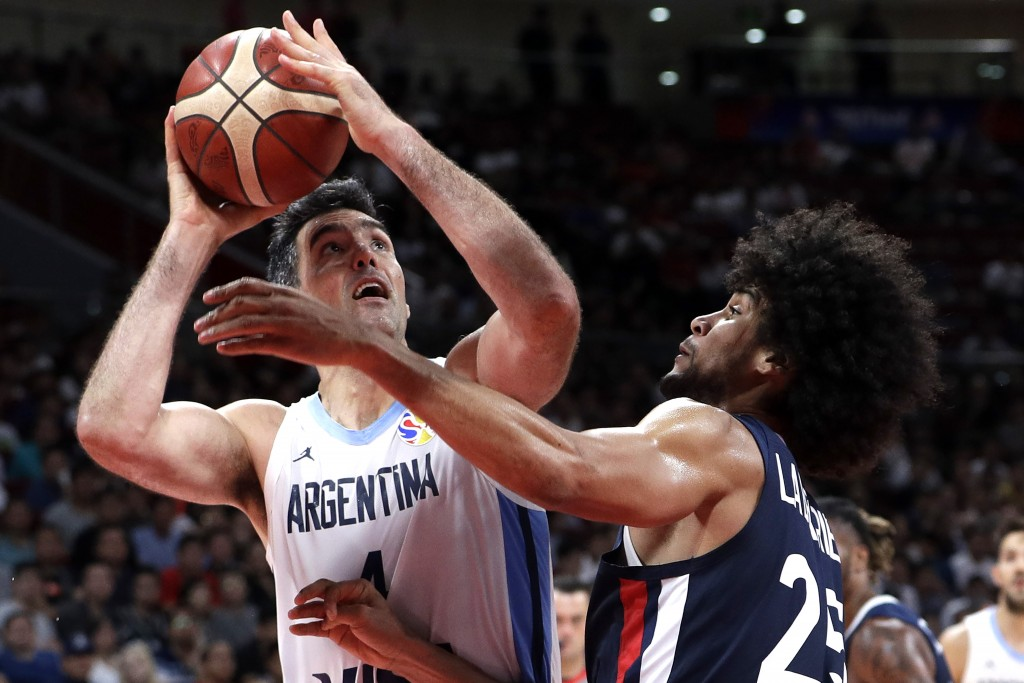 Luis Scola of Argentina puts up a shot over Louis Labeyrie of France during their semifinal match in the FIBA Basketball World Cup at the Cadillac Are...
