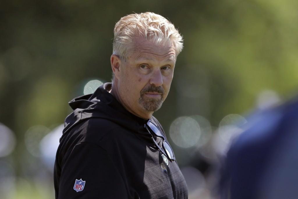 FILE - In this June 4, 2019, file photo, New York Jets defensive coordinator Gregg Williams looks on as his players run drills at the team's NFL footb...