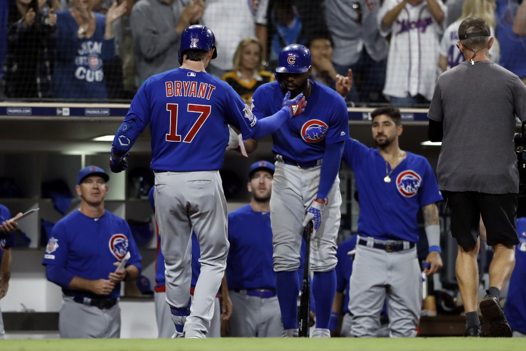Chicago Cubs' Kris Bryant (17) is greeted by teammates after hitting a two-run home run during the eighth inning of the team's baseball game against t...