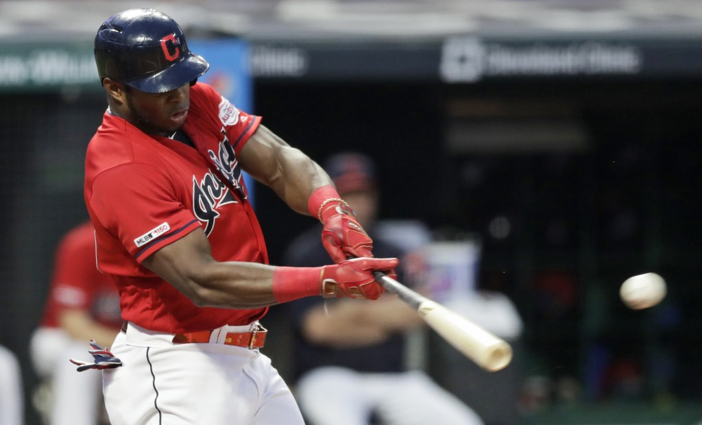 Cleveland Indians' Yasiel Puig hits an RBI-single in the first inning in a baseball game against the Minnesota Twins, Friday, Sept. 13, 2019, in Cleve...