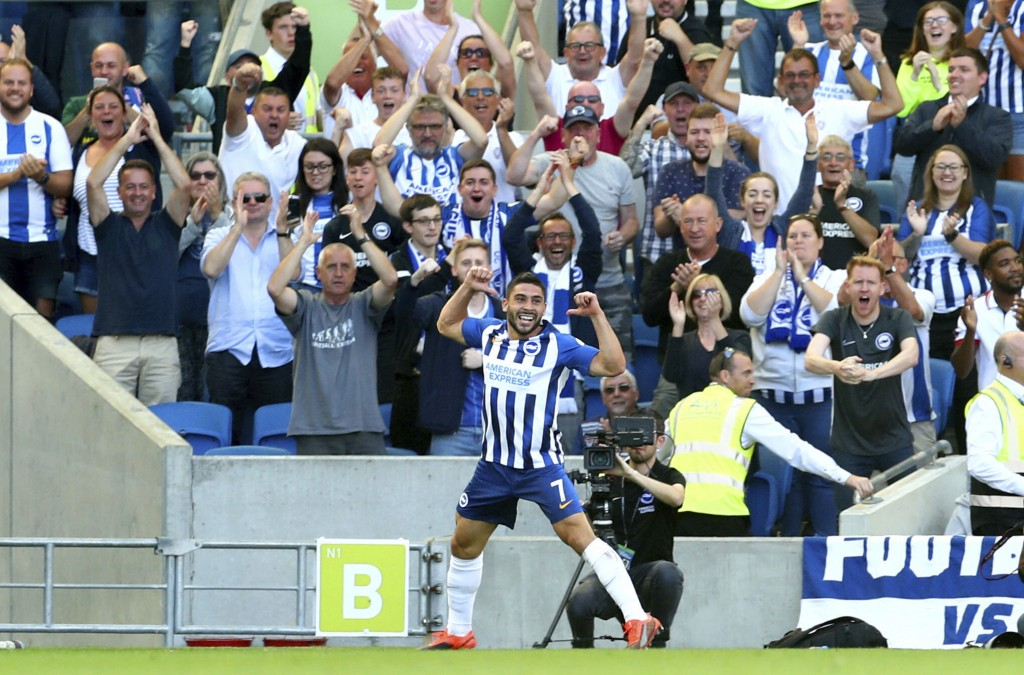 Brighton and Hove Albion's Neal Maupay celebrates scoring his side's first goal of the game during their English Premier League soccer match against B...