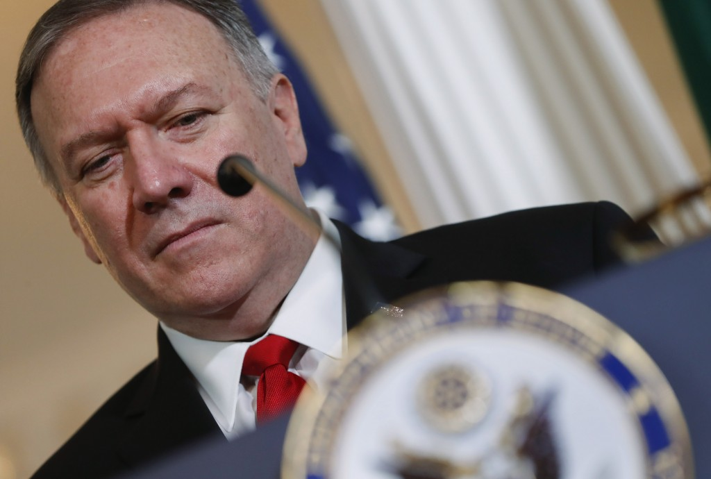Secretary of State Mike Pompeo listens to Brazilian Foreign Minister Ernesto Araujo deliver remarks to members of the media at the Department of State...