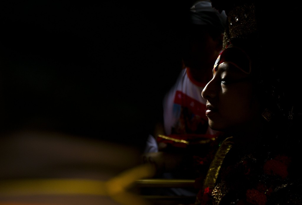 The living god Ganesh sits inside a chariot during Indra Jatra festival, an eight-day festival that honors Indra, the Hindu god of rain, in Kathmandu,...