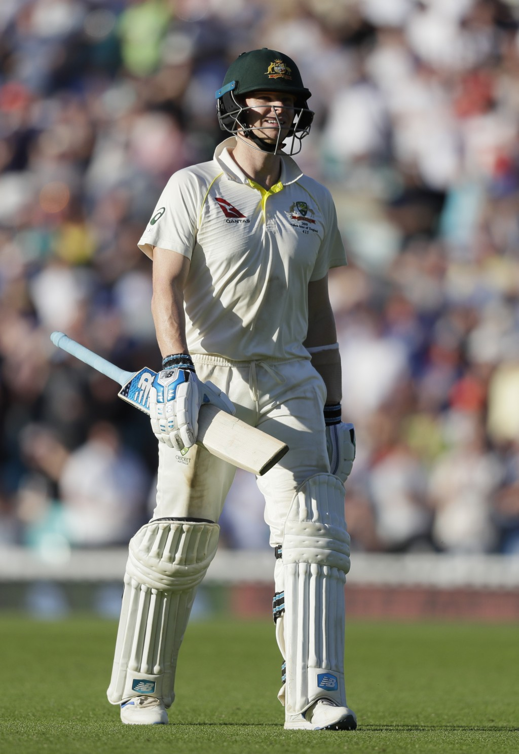 Australia's Steve Smith leaves the pitch after he is bowled lbw by England's Chris Woakes during the second day of the fifth Ashes test match between ...