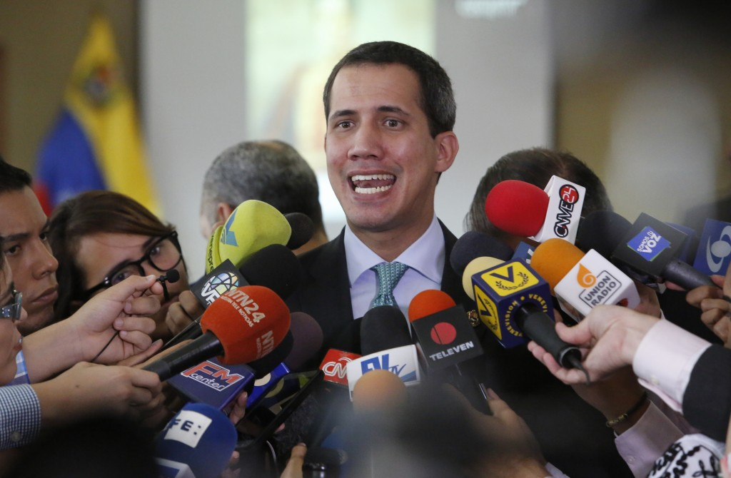 Venezuela's opposition leader and self-proclaimed interim President of Venezuela, Juan Guaidó, speaks to the press at the administrative headquarters