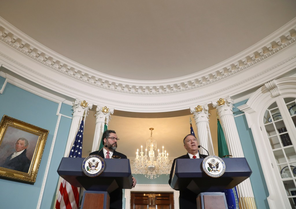 Secretary of State Mike Pompeo, right, and Brazilian Foreign Minister Ernesto Araujo, left, delivering remarks to members of the media at the Departme...