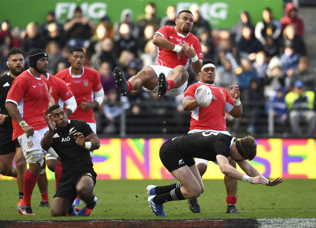 Tonga's James Faiva, top, collides with New Zealand's Jordie Barrett, bottom, during their rugby test match in Hamilton, New Zealand, Saturday, Sept. ...