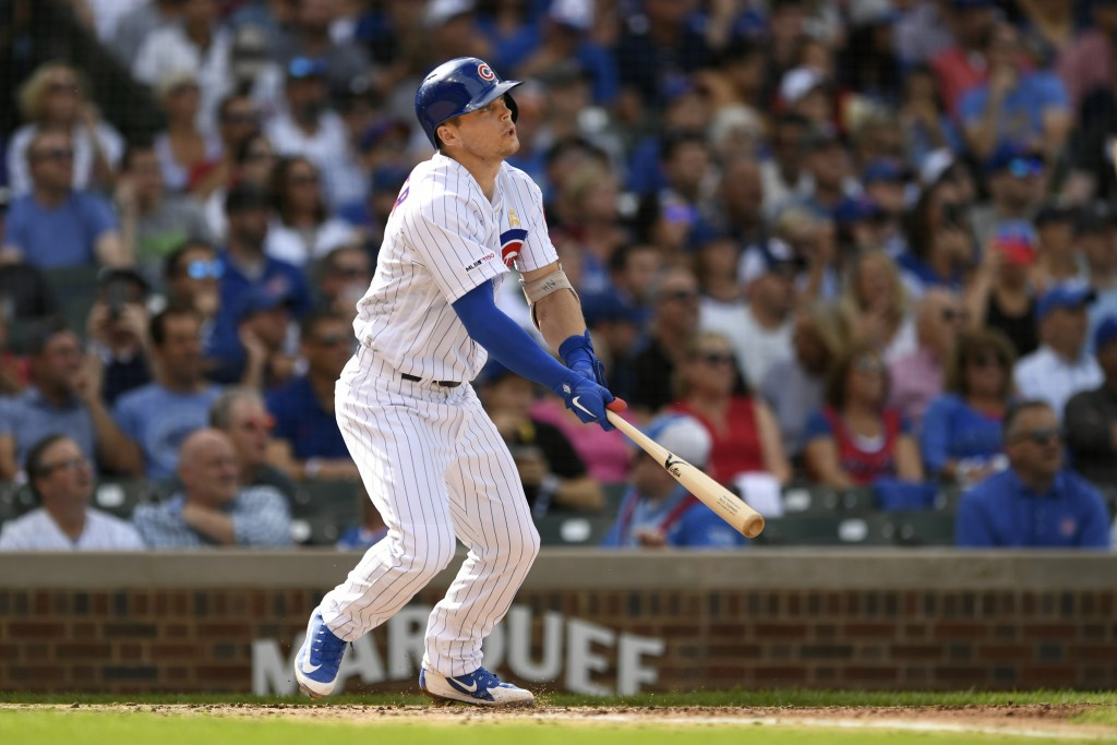Chicago Cubs' Nico Hoerner watches his two-run home run during the first inning of a baseball game against the Pittsburgh Pirates, Friday, Sept. 13, 2