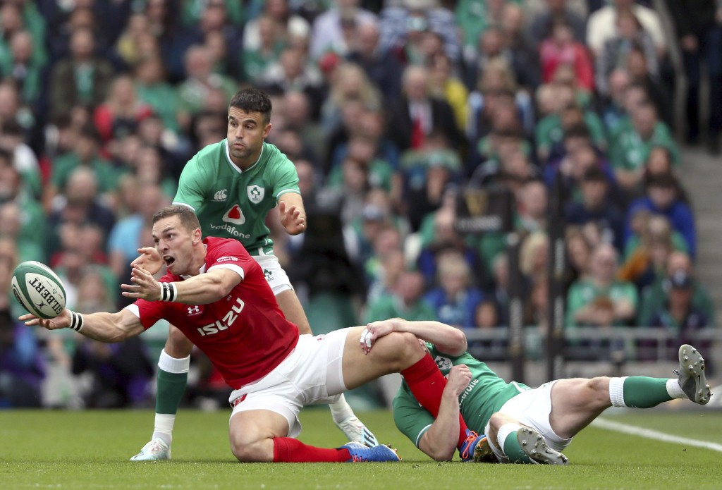 Wales' George North, left, is tackled by Ireland's Keith Earls during the summer series rugby match between Wales and Ireland at the Aviva Stadium, Du...