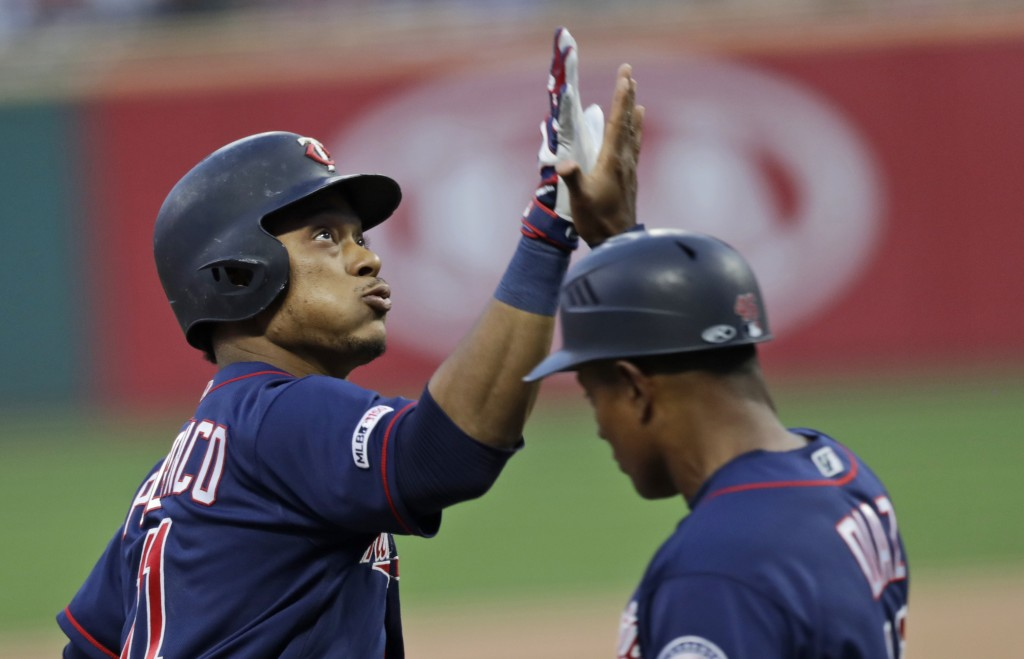 Minnesota Twins' Jorge Polanco, left, is congratulated by third base coach Tony Diaz after hitting a two-run home run in the first inning in a basebal...