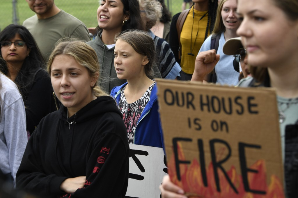 Swedish youth climate activist Greta Thunberg, center, marches with other young climate activists for a climate strike outside the White House in Wash...
