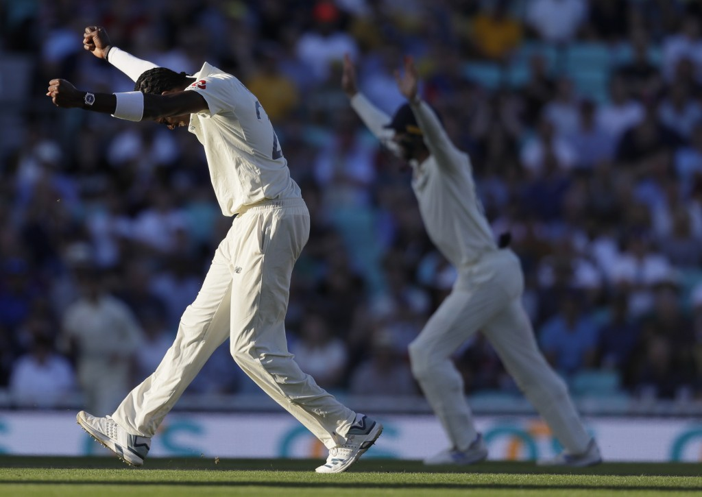 England's Jofra Archer celebrates taking the wicket of Australia's Peter Siddle during the second day of the fifth Ashes test match between England an...