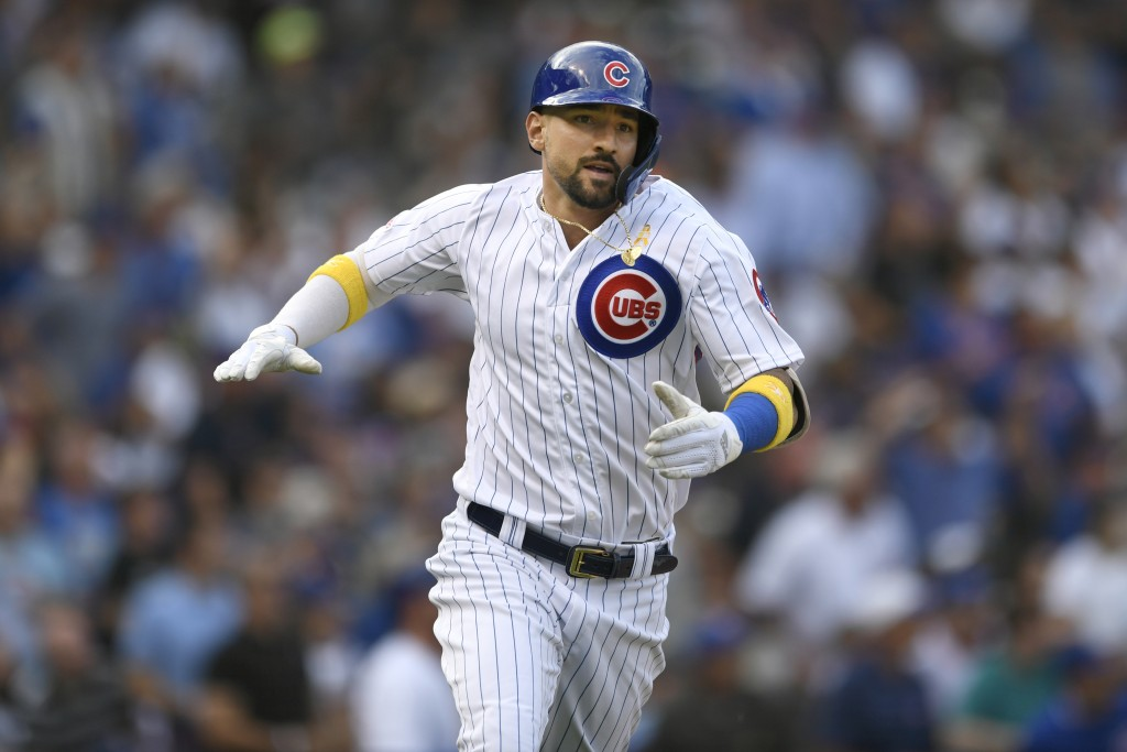 Chicago Cubs' Nicholas Castellanos celebrates after hitting a two-run home run during the first inning of a baseball game against the Pittsburgh Pirat