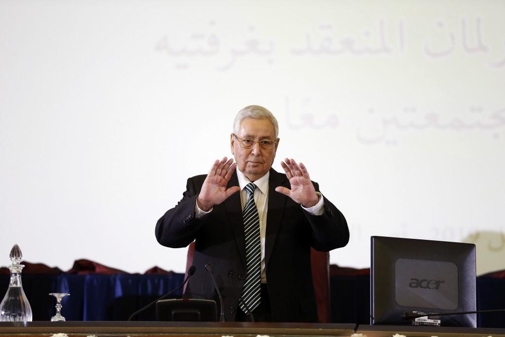 FILE - In this April 9, 2019 file photo, Abdelkader Bensalah gestures while being named interim leader to replace former Algerian President Abdelaziz ...