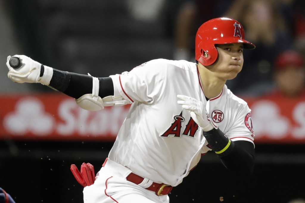 Los Angeles Angels' Shohei Ohtani, of Japan, watches a foul ball during the third inning of a baseball game against the Cleveland Indians in Anaheim, ...