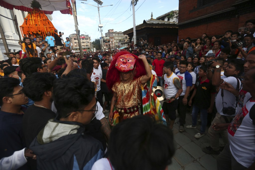 A traditional mask dancer, known as Lakhe, performs during Indra Jatra festival, an eight-day festival that honors Indra, the Hindu god of rain, in Ka