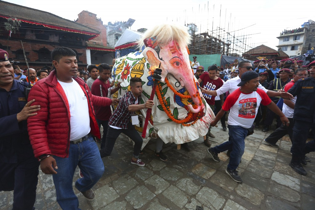 Nepalese devotees perform a traditional elephant dance during Indra Jatra festival, an eight-day festival that honors Indra, the Hindu god of rain, in
