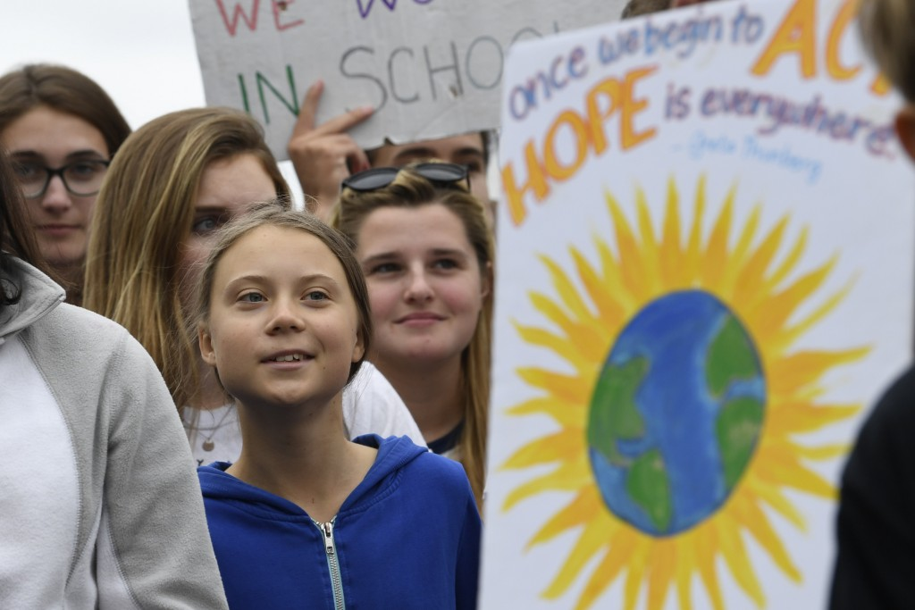 Swedish youth climate activist Greta Thunberg, center in blue, joins other young climate activists Friday for a climate strike outside the White House...