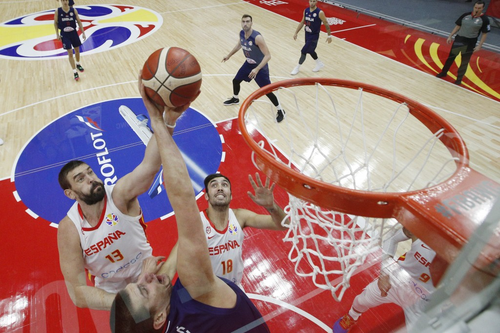 Marc Gasol of Spain is tackled by Nikola Jovic of Serbia as he attempt for a shot during their Group J second phase match for the FIBA Basketball Worl...