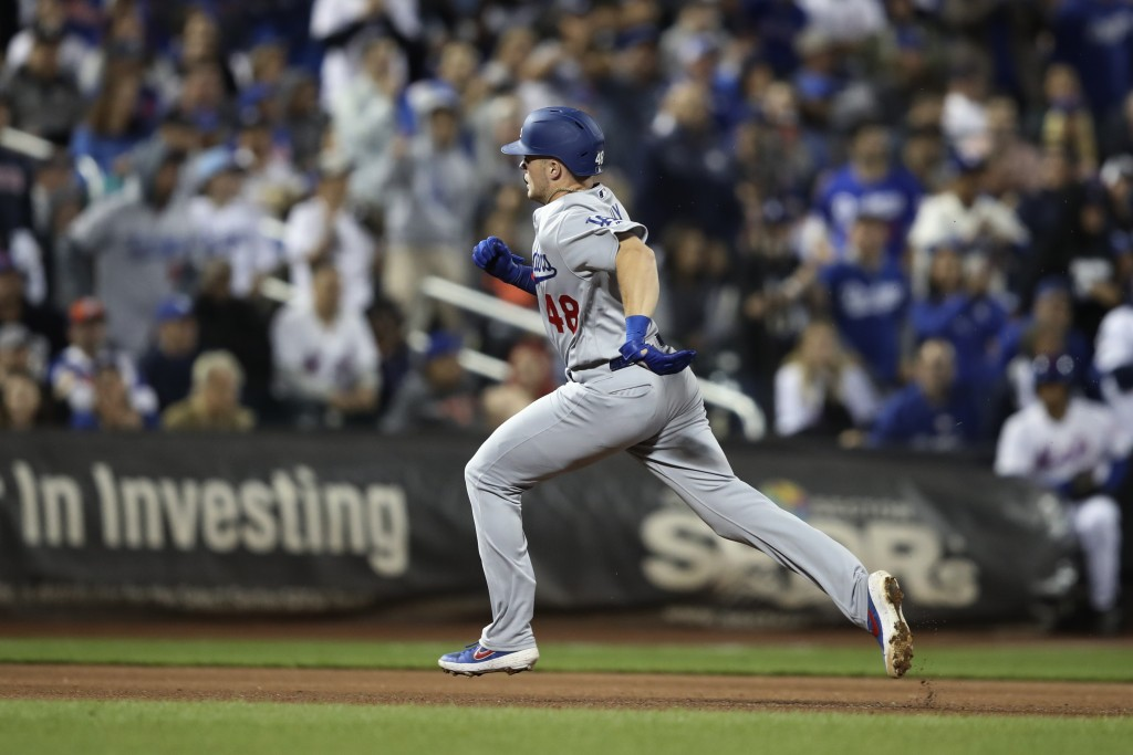 Los Angeles Dodgers' Gavin Lux runs the bases after hitting a three-run home run during the fourth inning of the team's baseball game against the New ...
