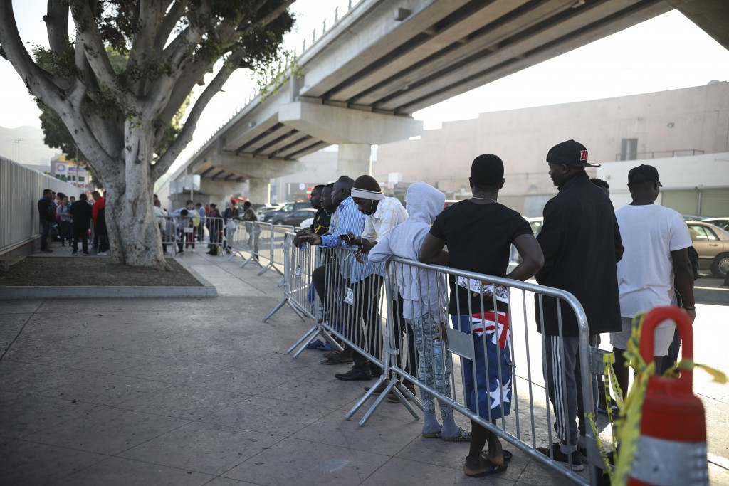 Migrants from Haiti, Africa, and Central America wait to see if their number will be called to cross the border and apply for asylum in the United Sta...