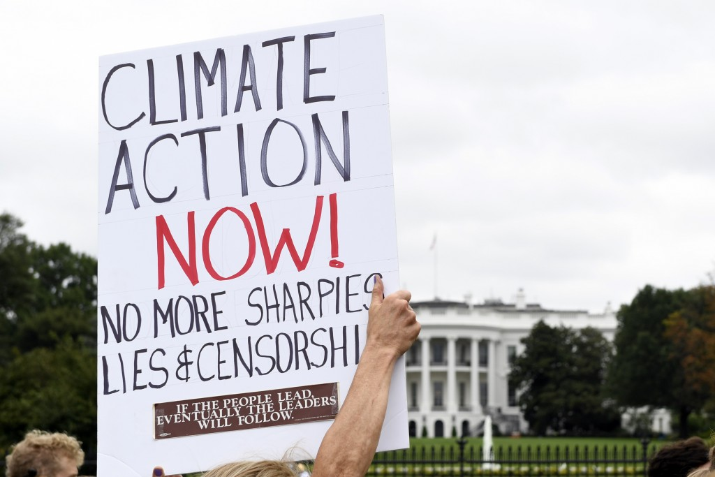 Activists protest during a rally outside the White House in Washington, Friday, Sept. 13, 2019. (AP Photo/Susan Walsh)