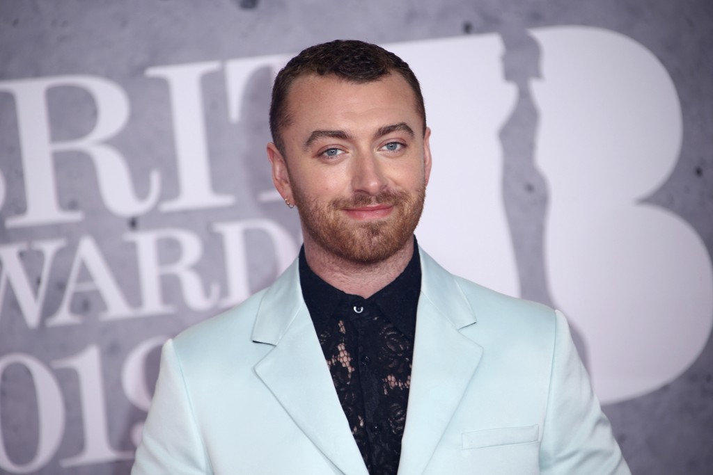 File-This Feb. 20, 2019, file photo shows singer Sam Smith posing for photographers upon arrival at the Brit Awards in London. The Oscar-winning pop s...
