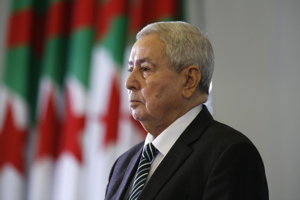 FILE - In this April 9, 2019 file photo, Abdelkader Bensalah stands while being named interim leader to replace former Algerian President Abdelaziz Bo...