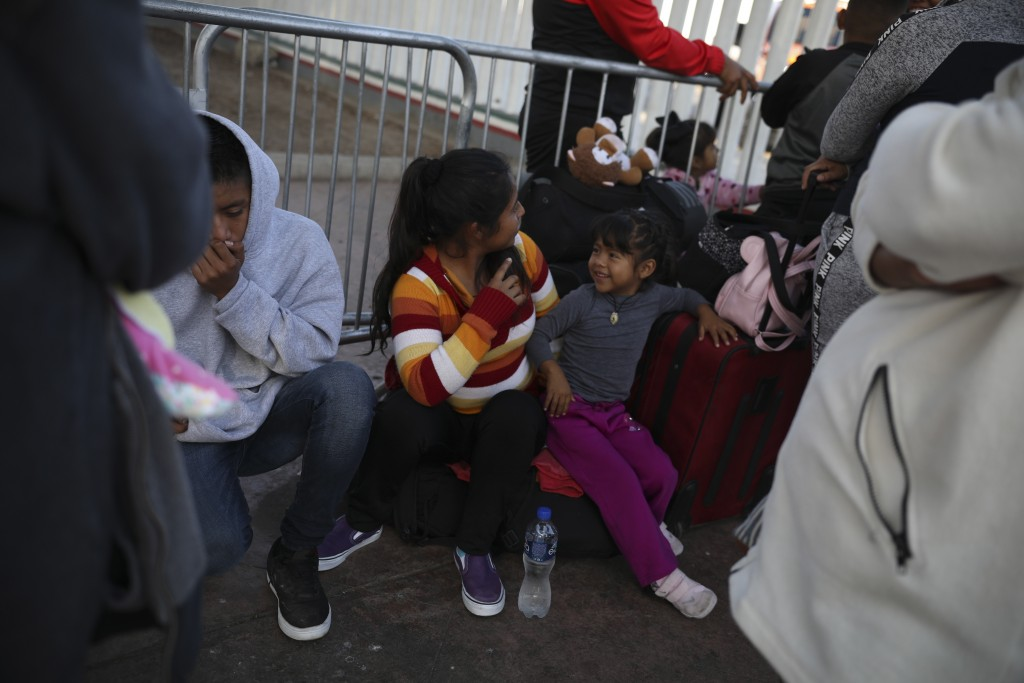 Central American migrants wait to see if their number will be called that day to cross the border and apply for asylum in the United States, at the El
