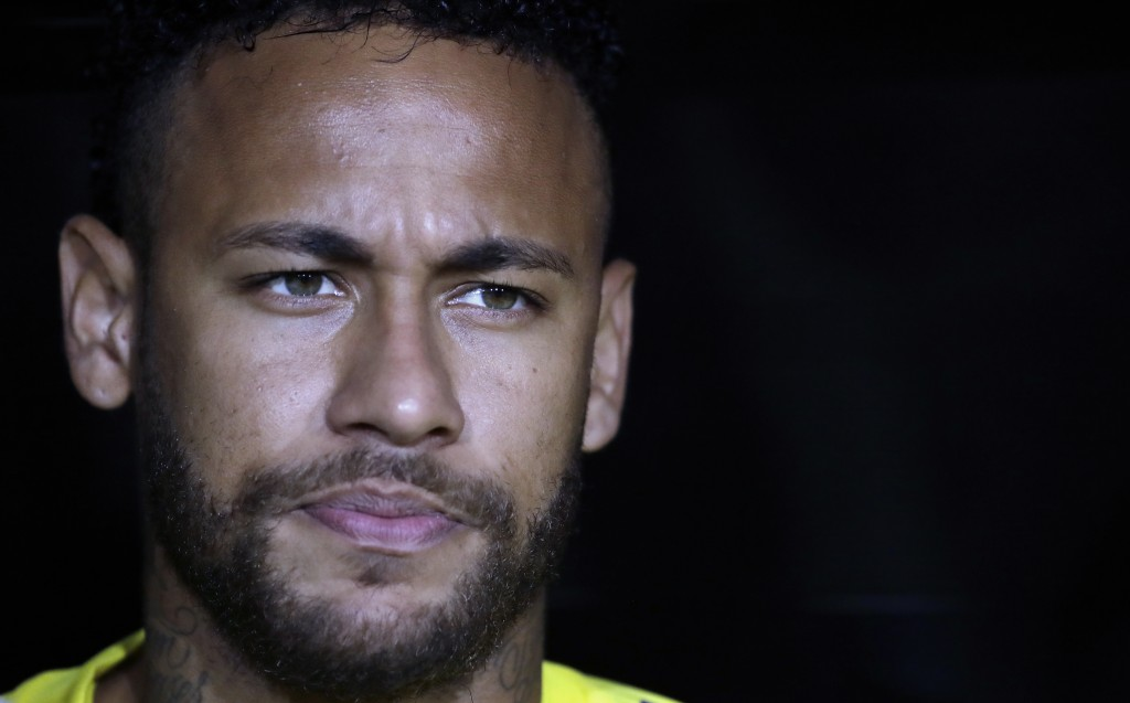 FILE - In this Tuesday, Sept. 10, 2019 file photo, Brazil's Neymar Jr. listens to his country's national anthem before an international friendly socce...