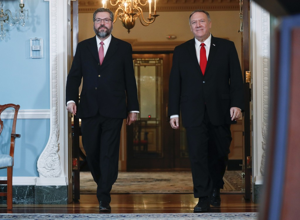 Secretary of State Mike Pompeo, right, and Brazilian Foreign Minister Ernesto Araujo, left, walk out to deliver remarks to members of the media at the