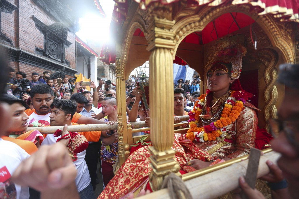 Devotees carry the chariot of living god Bhairabh during Indra Jatra festival, an eight-day festival that honors Indra, the Hindu god of rain, in Kath...