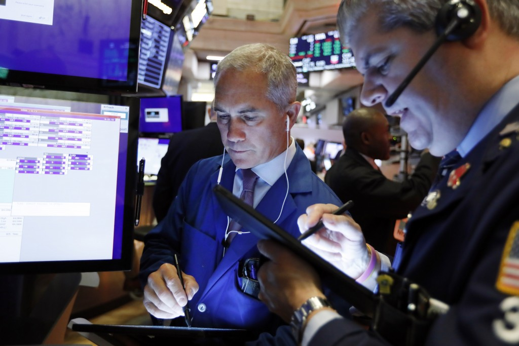 Trader Timothy Nick, left, works on the floor of the New York Stock Exchange, Friday, Sept. 13, 2019. Stocks are having a mixed performance early on W