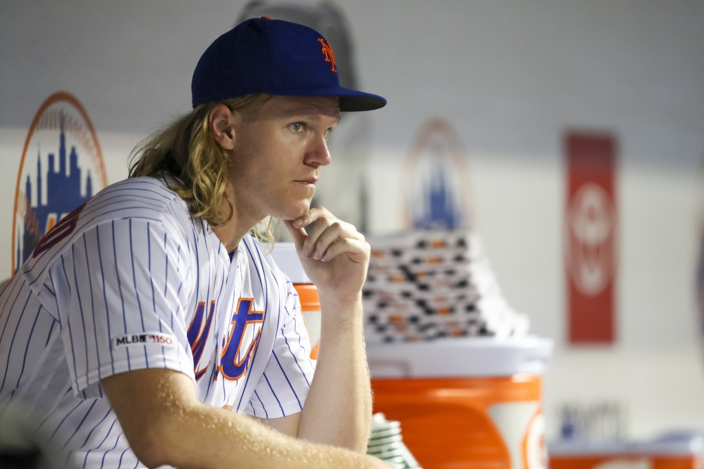 New York Mets starting pitcher Noah Syndergaard watches during the fourth inning of the team's baseball game against the Los Angeles Dodgers on Friday...