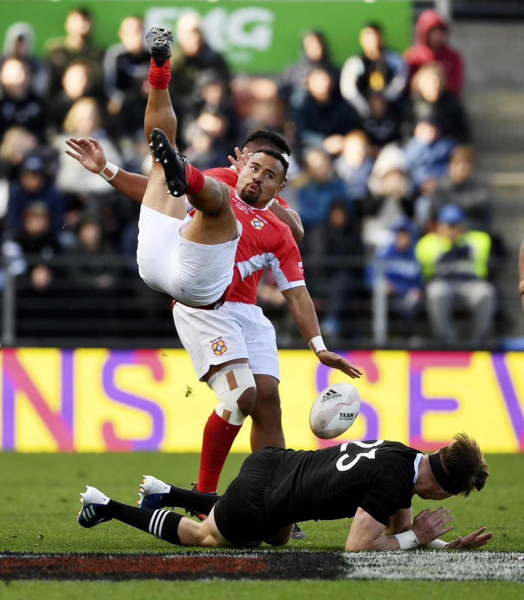 Tonga's James Faiva, top, collides with New Zealand's Jordie Barrett during their rugby test match in Hamilton, New Zealand, Saturday, Sept. 7, 2019. ...