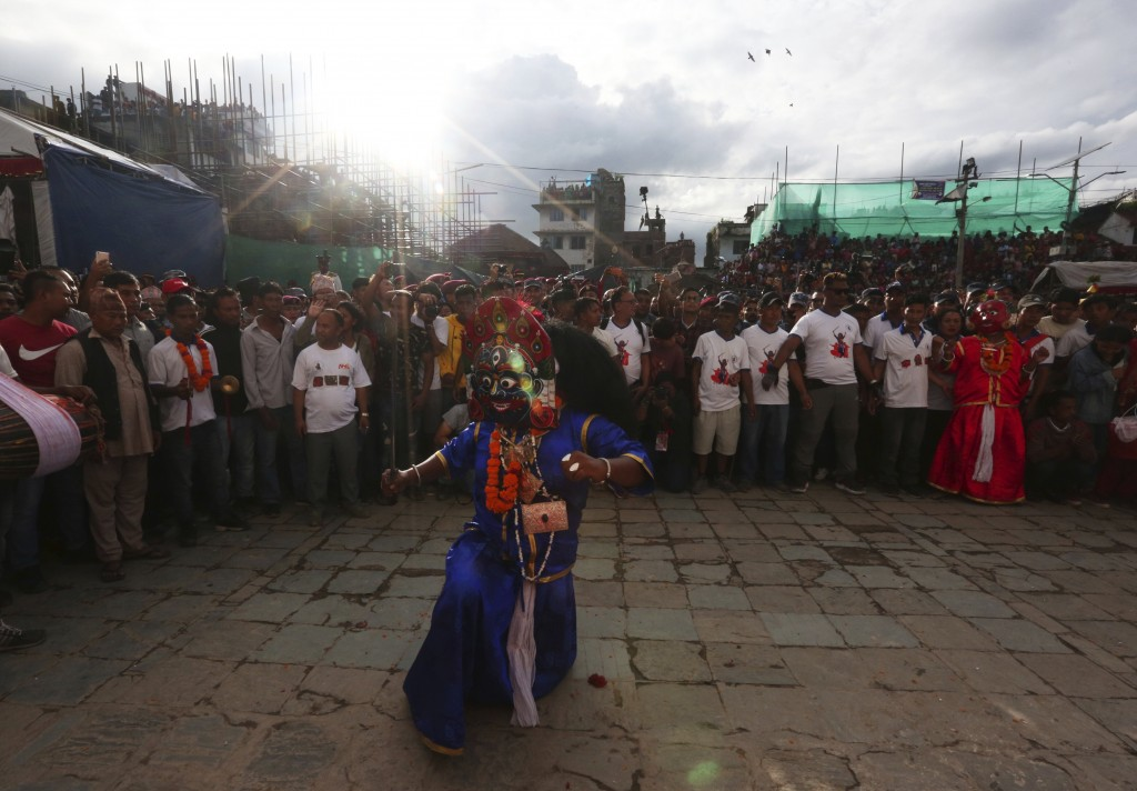 Masked dancers perform a traditional during Indra Jatra festival, an eight-day festival that honors Indra, the Hindu god of rain, in Kathmandu, Nepal,...