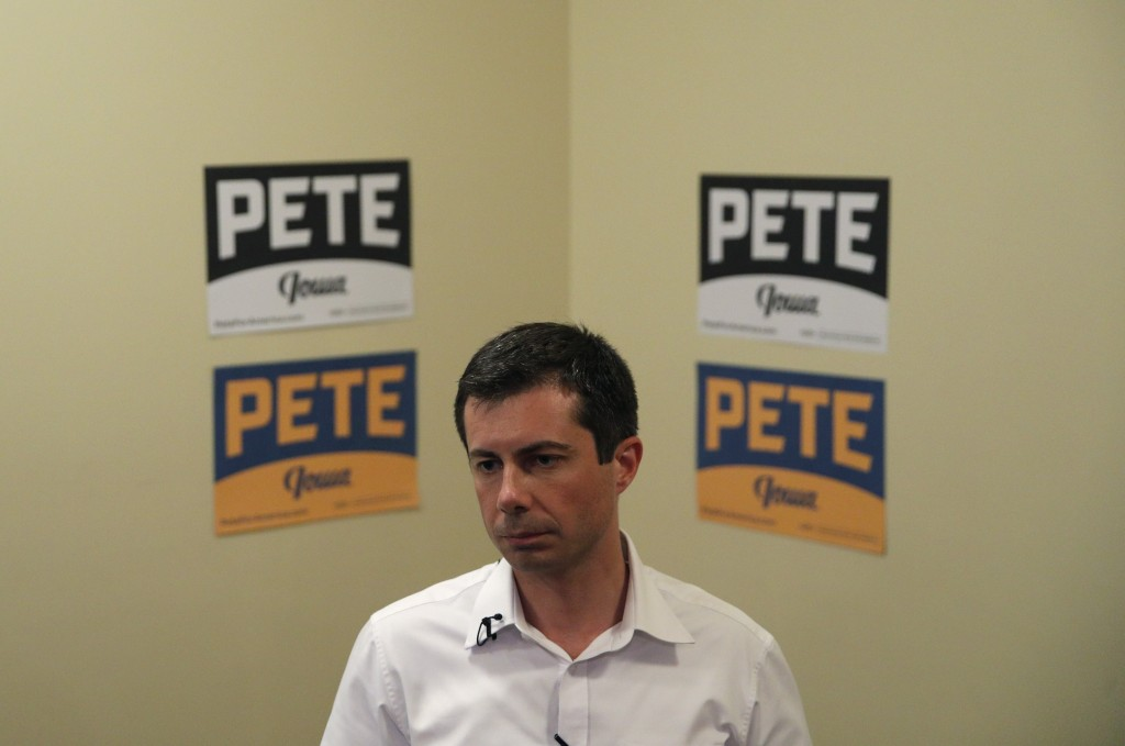 FILE - In this Aug. 15, 2019, file photo, Democratic presidential candidate South Bend Mayor Pete Buttigieg speaks with the media after a campaign eve...