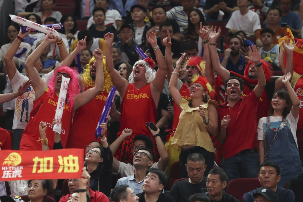 Spanish fans cheers during their FIBA Basketball World Cup Finalmatch against Argentina, at the Cadillac Arena in Beijing, Sunday, Sept. 15, 2019. (AP