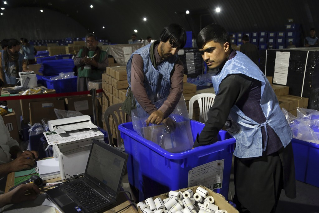 Election commission workers prepare ballot boxes and election materials for the presidential election scheduled for Sept 28, at the Independent Electi